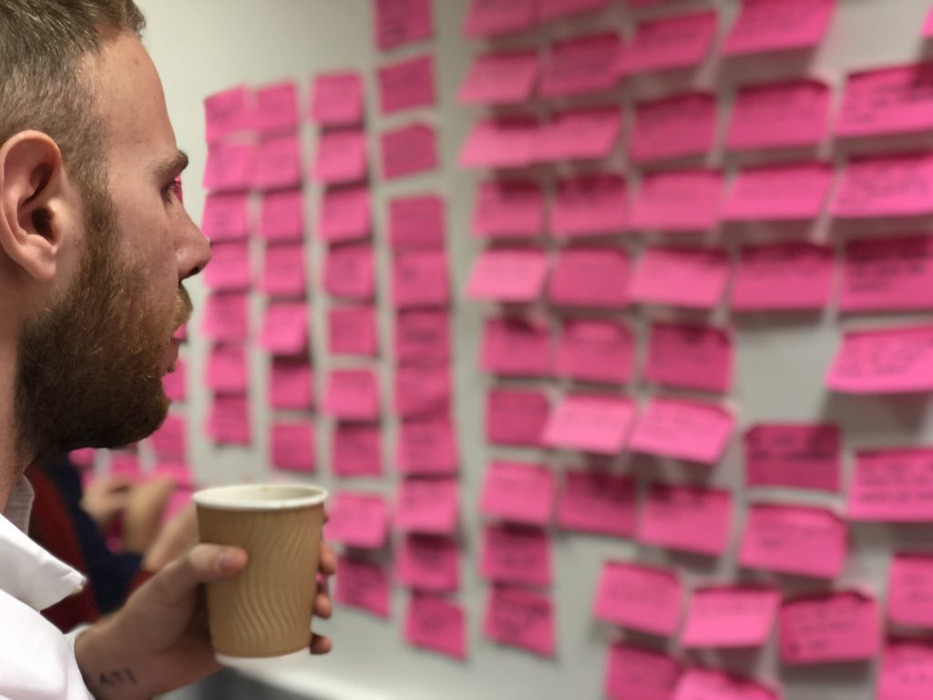 A member of the SMILE team planning out work using post-it notes