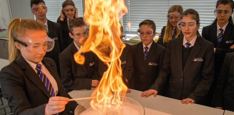 Delta Trust image of students in the science lab with fire